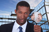A black man showing a couple dispute through a magnifying glass — Stock Photo