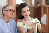 Young woman helping senior lady with the cleaning — Stock Photo