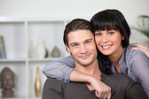 Young couple at ease together at home — Stock Photo