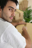Man packing moving box — Stock Photo
