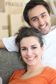 Joyous couple moving house — Stock Photo