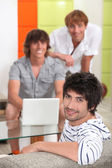 Three young men in the lounge — Stock Photo