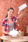 Portrait of a woman with moving box — Stock Photo