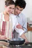 Couple cooking in their kitchen — Stock Photo
