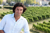 Man stood by vineyard — Stock Photo