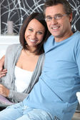 Smiling couple at home — Stock Photo
