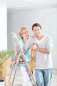 Couple redecorating home — Stock Photo