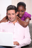 Couple looking at a laptop computer at home — Stock Photo