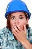 Shocked woman wearing a hard hat — Stock Photo