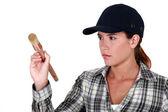 Woman holding a paintbrush — Stock Photo