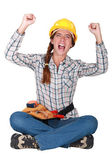 An ecstatic female construction worker. — Stockfoto