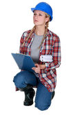 Female construction worker with a clipboard — Stock Photo