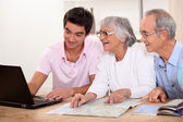 Grandson helping grandparent plan route — Stock Photo