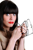 Attractive woman with many pairs of glasses — Stock Photo