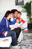 French football fans watching a televised match — Stock Photo