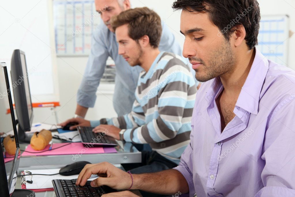 Young men working on computers — Stock Photo #7622919
