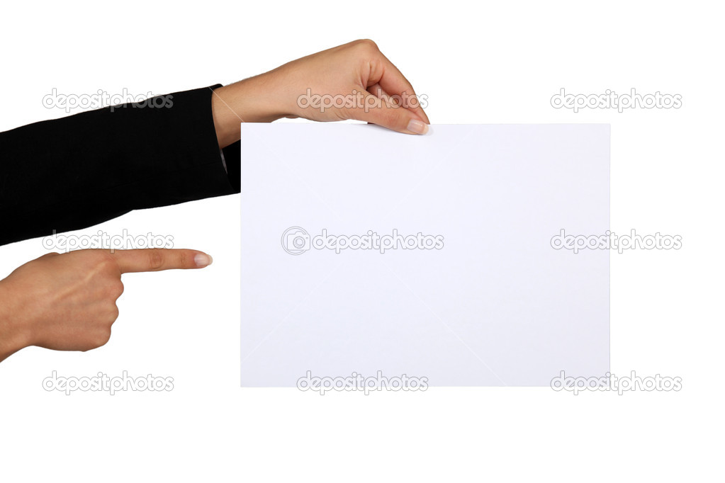Businesswoman pointing at a blank piece of paper — Photo #7624522