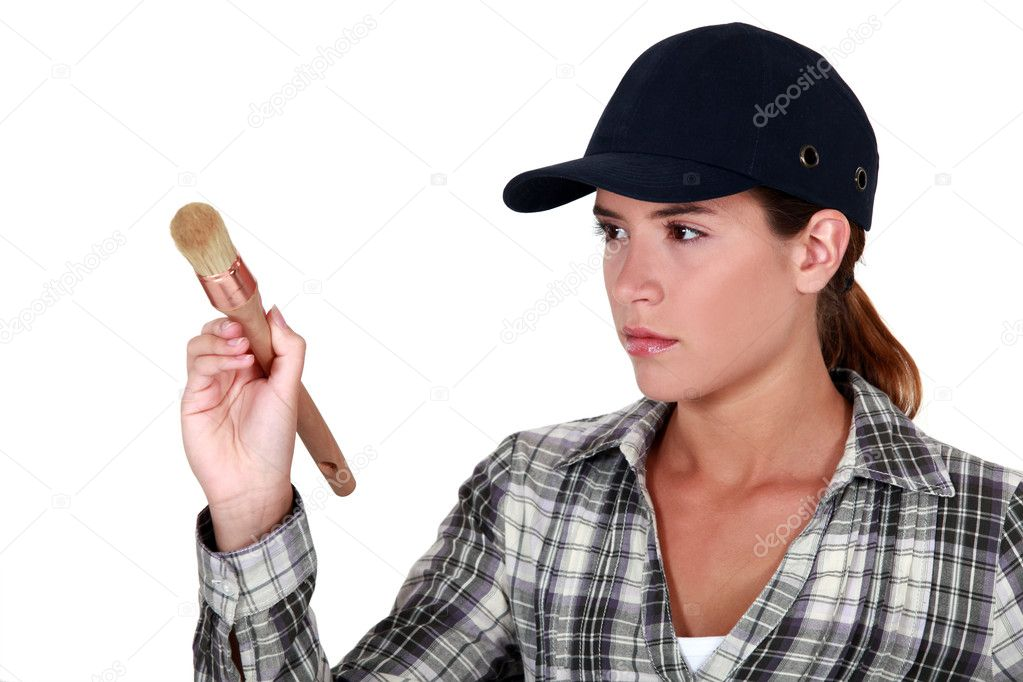 Woman holding a paintbrush  Stock Photo #7625172