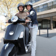 Couple about to ride scooter — Stock Photo #7659023
