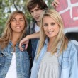 Stock Photo: Portrait of a boy and 2 girls