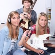 Teenagers making music in a bedroom — Stock Photo #7659659