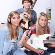 Royalty-Free Stock Photo: Teenagers making music in a bedroom