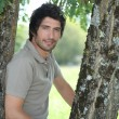 Stockfoto: Mstanding between trees