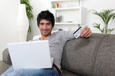 Man doing shopping on the Internet — Stock Photo