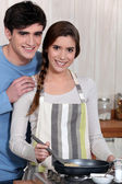 Young couple cooking together — Stock Photo