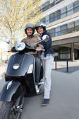 Couple about to ride scooter — Stock Photo