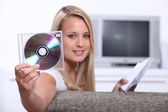 Girl listening to CDs — Stok fotoğraf