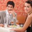Couple having romantic meal in restaurant — Stock Photo
