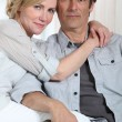 Stock Photo: Couple sat closely
