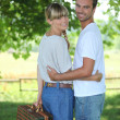 Young couple going on a picnic — Stock Photo