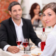 Couple having meal in restaurant — Stock Photo #7660774