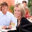 Stock Photo: Happy couple at restaurant