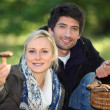 Couple picking mushrooms in a forest — Stock Photo #7660939