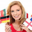 Girl holding a bunch of national flags — Stok fotoğraf