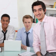 Three men in an office — Stockfoto
