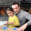 Young girl playing a game with her father - Stock Photo