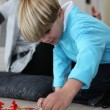 Little boy playing a board game — Stock Photo