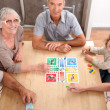 Stock Photo: Family playing board games.