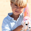 Stock Photo: Boy carrying parasol