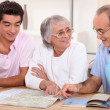 Family planning a holiday — Stock Photo