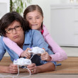 Stock Photo: Young girl playing video game with her grandmother
