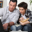 Stock Photo: Father and son about to watch game on computer.