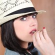 Stylish brunette wearing straw hat — Stock Photo