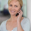 Portrait of a woman on the phone — Stock Photo #7663599