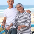 Senior man and senior woman at the beach — Stock Photo