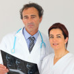 Medics looking at an x-ray — Stock Photo